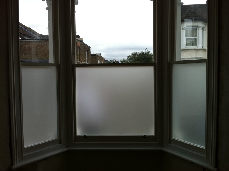 Existing original frame has had double glazed sash windows fitted with lower, internal pane frosted for extra privacy