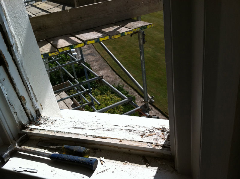 Sash window sill and frame requiring replacement.