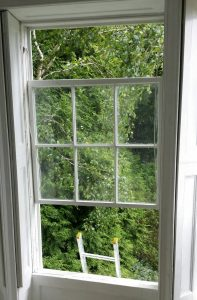 sash window partially built and being decorated