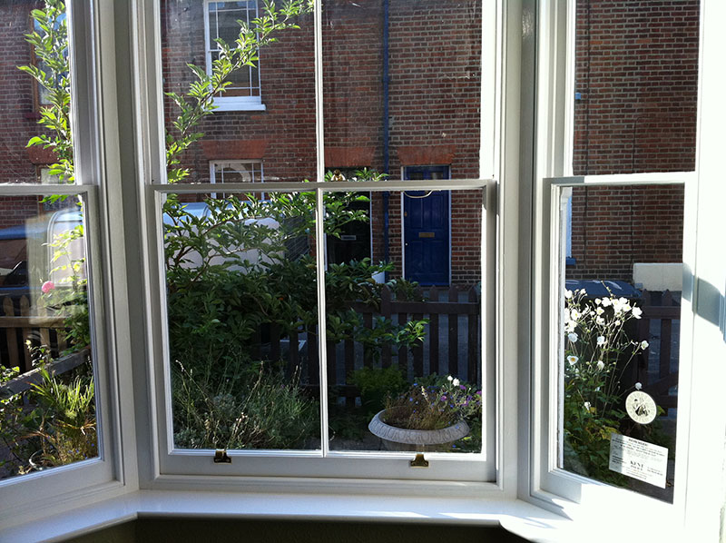 Freshly decorated sash windows sticking