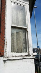 Repair sash windows side of bay