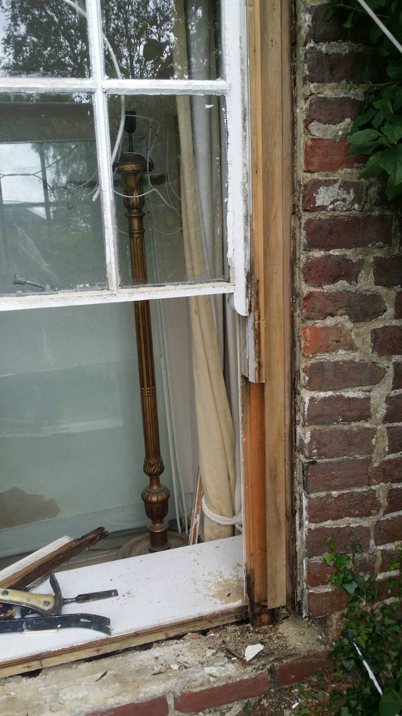 Sash window sill removed and exposed damage right through to the inside