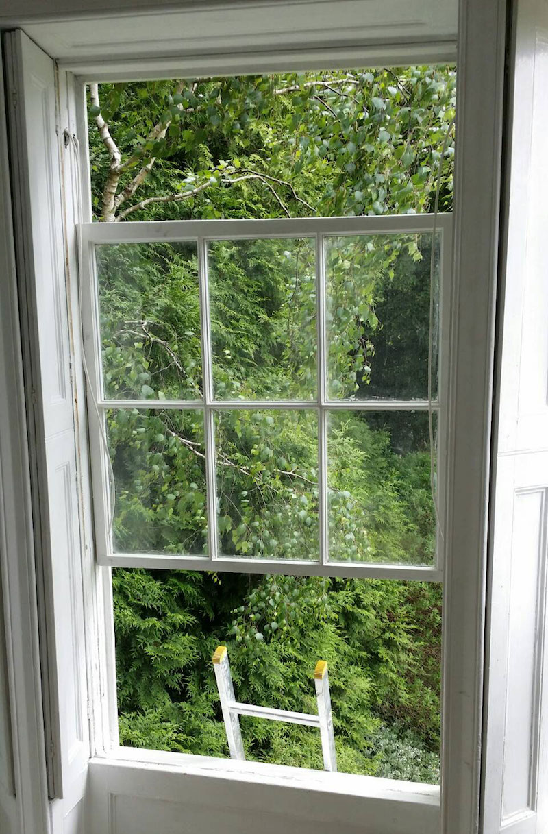 Timber sash window rebuilt after undercoating to avoid damage to gloss