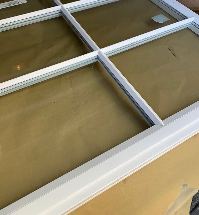 Notice how the edge is cut out and rebated from this double glazed sash window? This is to allow the sash to pass the front cheek of the frame.