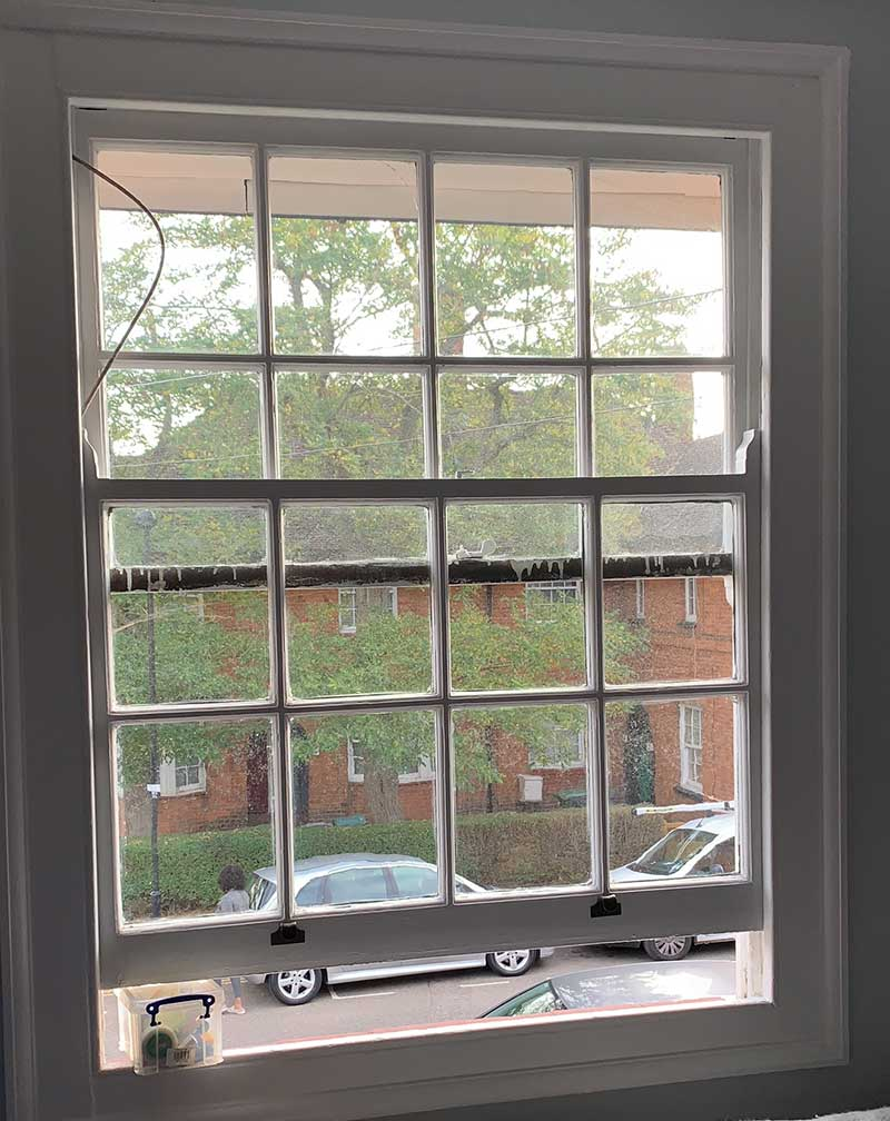 Single glazed sash window before replacement
