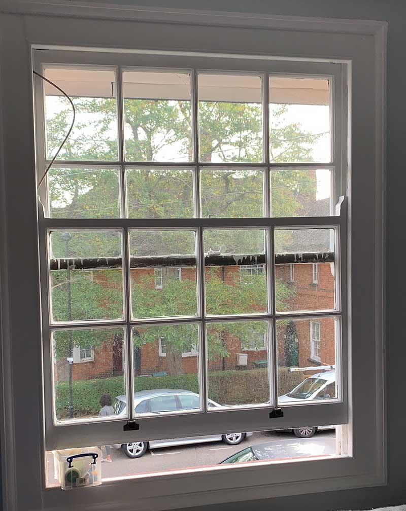 Single glazed sash window before replacement