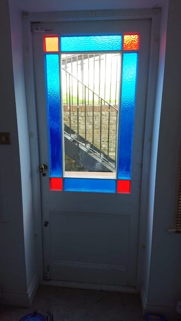 Marginal light thin double glazed door – red and blue glass