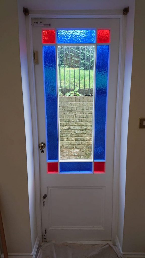 Single glazed colour glass doors prior to double glazing