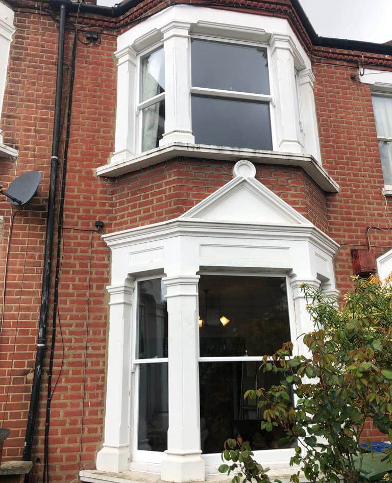 Front of property after we removed the aluminium inserts and installed the double glazed sash