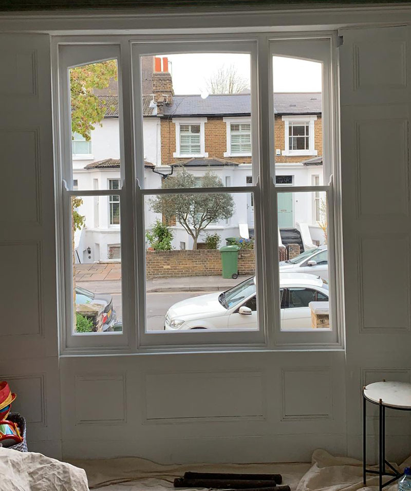 New arched double glazed Venetian sash windows offered in and ready for fitting