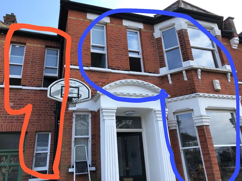 New double glazed sash and original retrofitted sash compared on the same building