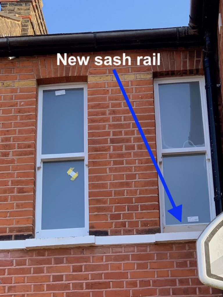 Retrofitted double glazed sash window with a lower rail splice replacement